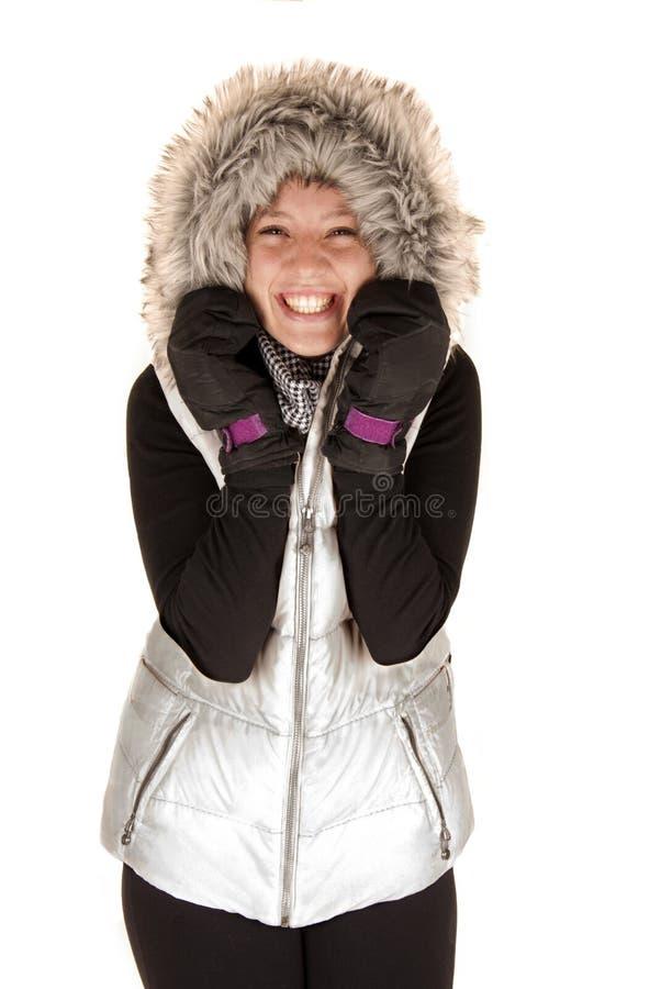 Mujer en la expresión emocionada del abrigo de invierno y de los guantes fotografía de archivo