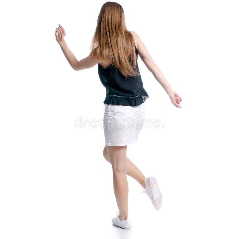 Mujer en la falda blanca y la felicidad de baile negra fotografía de archivo libre de regalías