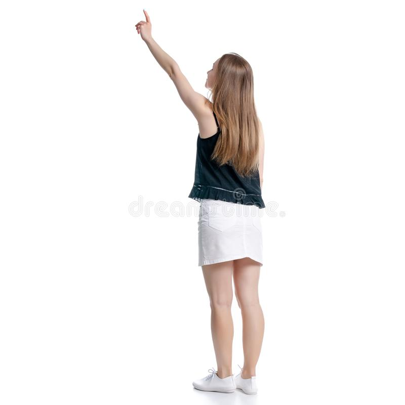 Mujer en la falda blanca y se?alar negro de la demostraci?n imágenes de archivo libres de regalías
