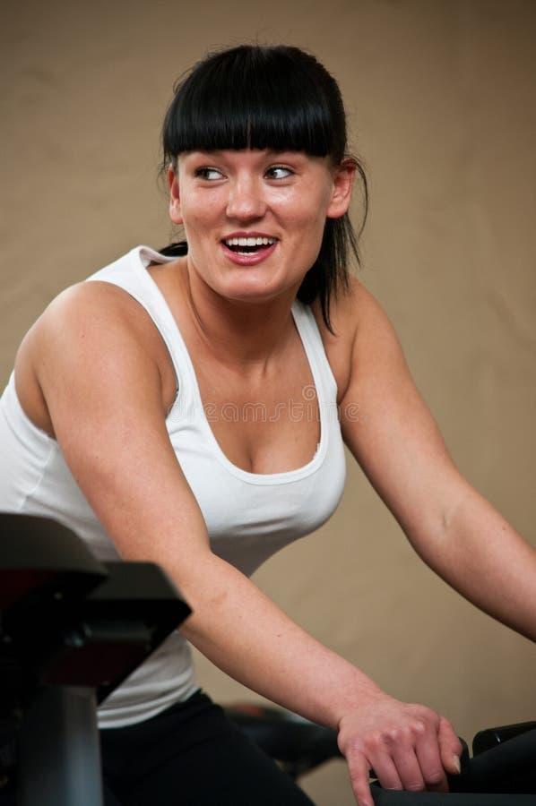 Mujer en la gimnasia fotos de archivo