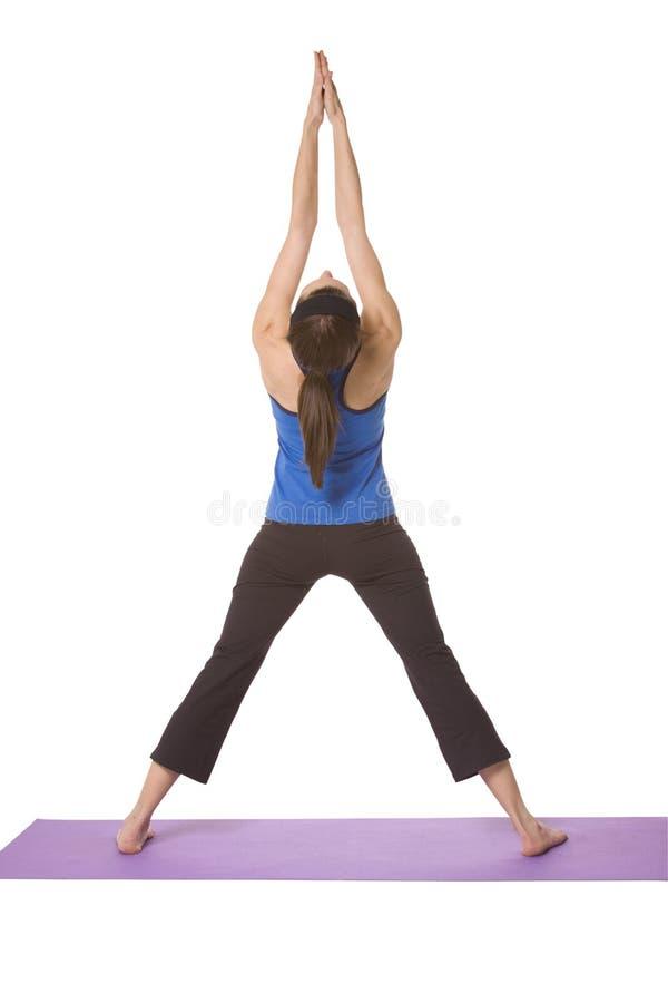Mujer en la posición de la yoga fotografía de archivo