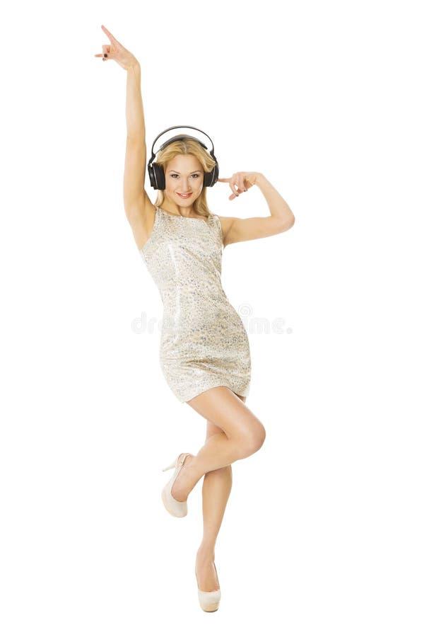 Mujer en los headpnones que bailan escuchar la música, aislada sobre blanco fotografía de archivo libre de regalías