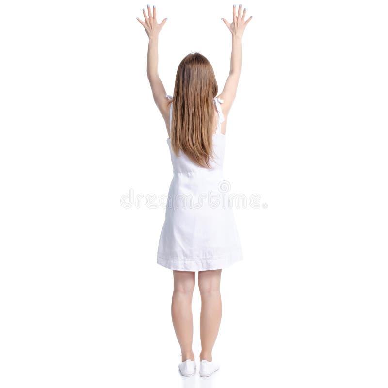 Mujer en manos permanentes del vestido blanco para arriba foto de archivo