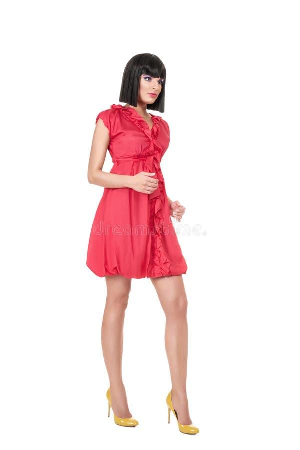 Mujer en mini vestido rojo fotografía de archivo