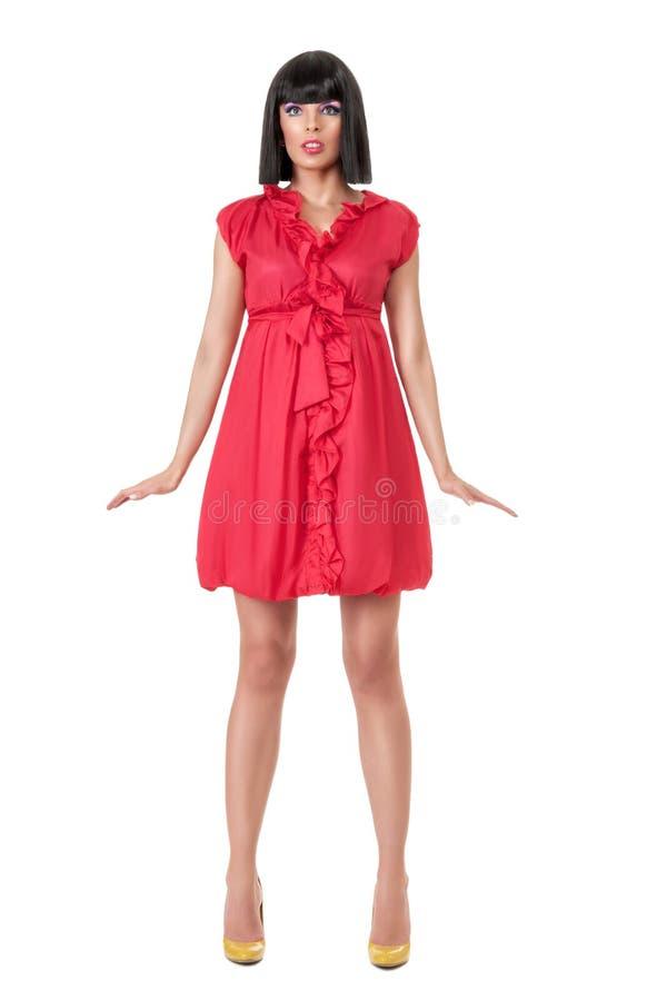 Mujer en mini vestido rojo imágenes de archivo libres de regalías