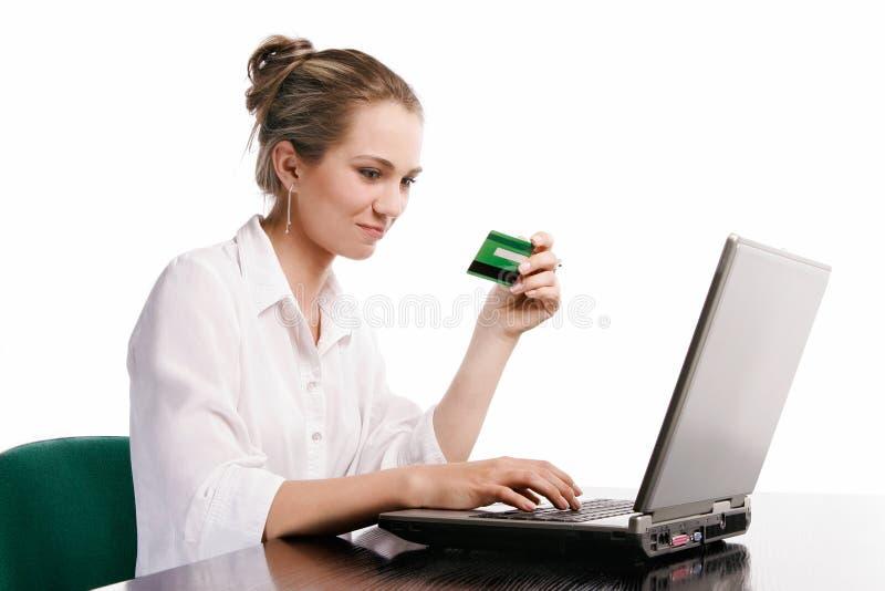 Mujer en oficina en el fondo blanco foto de archivo libre de regalías