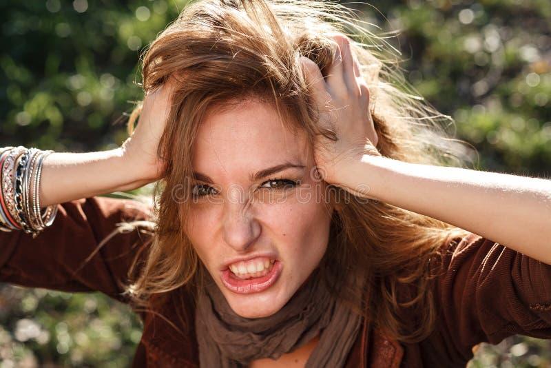 Mujer en rabia imagen de archivo libre de regalías