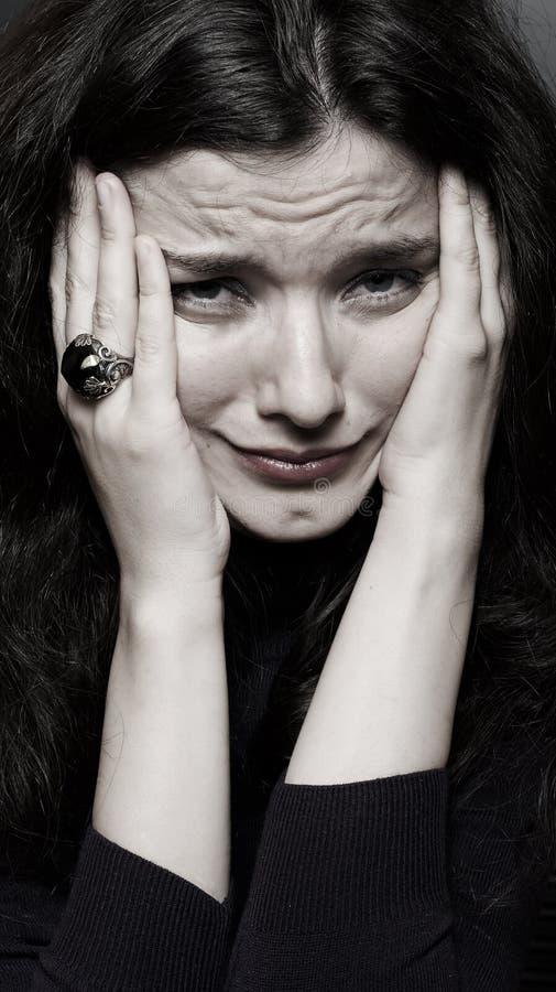 Mujer en rasgones imagen de archivo libre de regalías