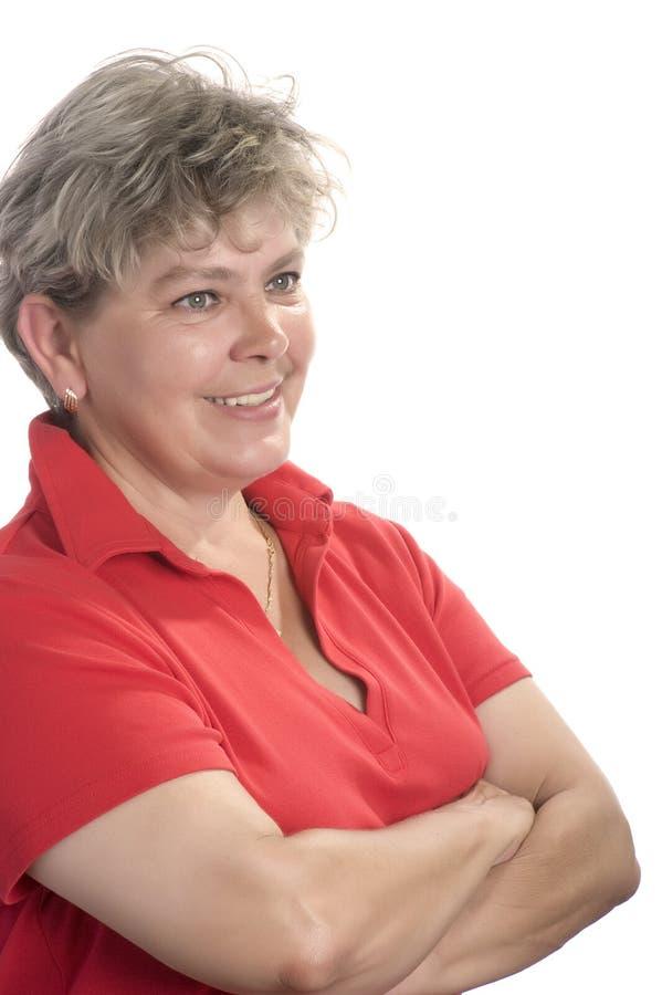 Mujer en rojo en cierre del blanco para arriba imágenes de archivo libres de regalías