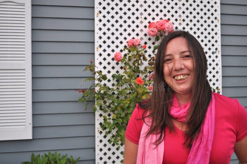 Mujer en rosa fotografía de archivo