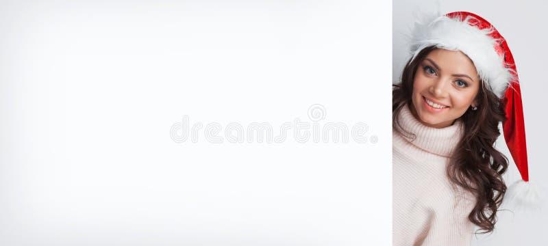 Mujer en sombrero del `s de Santa fotografía de archivo libre de regalías