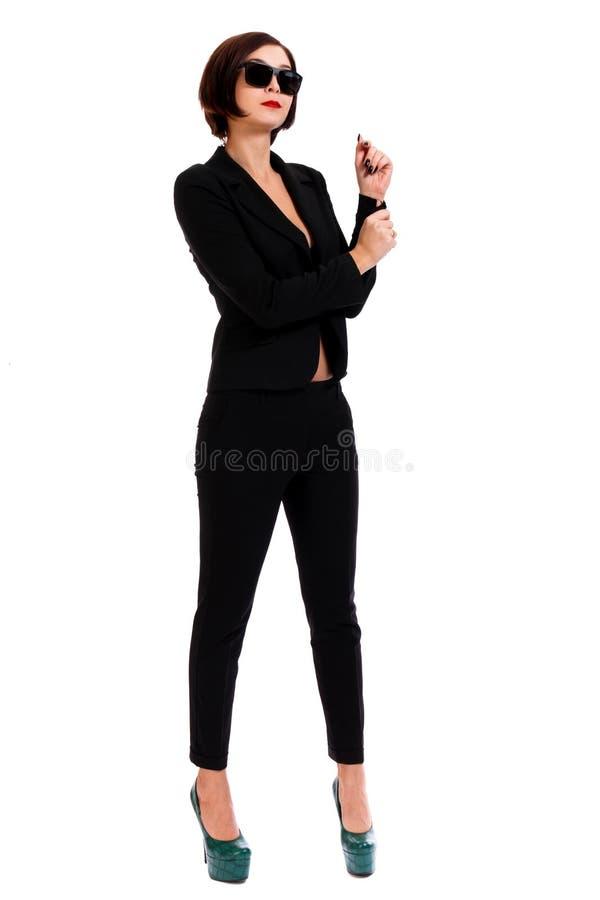 Mujer en un juego negro imagenes de archivo