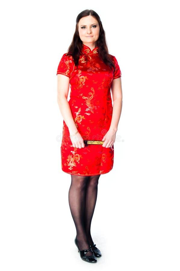 Mujer en un vestido rojo del chino fotografía de archivo libre de regalías