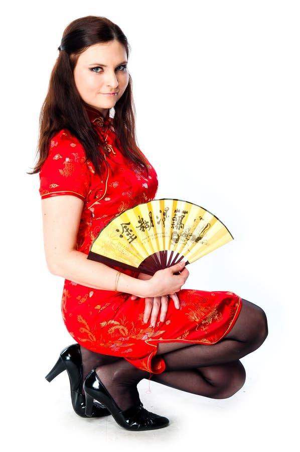 Mujer en un vestido rojo del chino imágenes de archivo libres de regalías