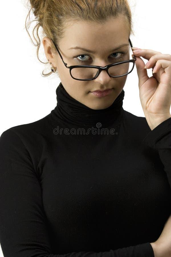 Mujer en vidrios fotografía de archivo libre de regalías