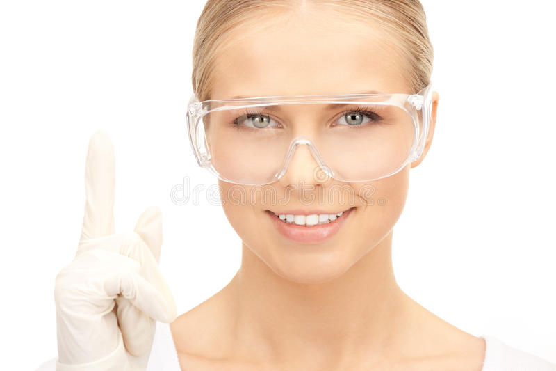 Mujer en vidrios y guantes protectores imagenes de archivo
