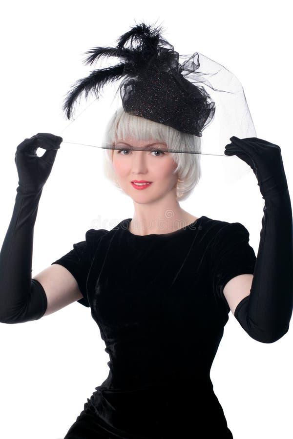 Mujer encantadora en estilo retro en sombrero imagen de archivo