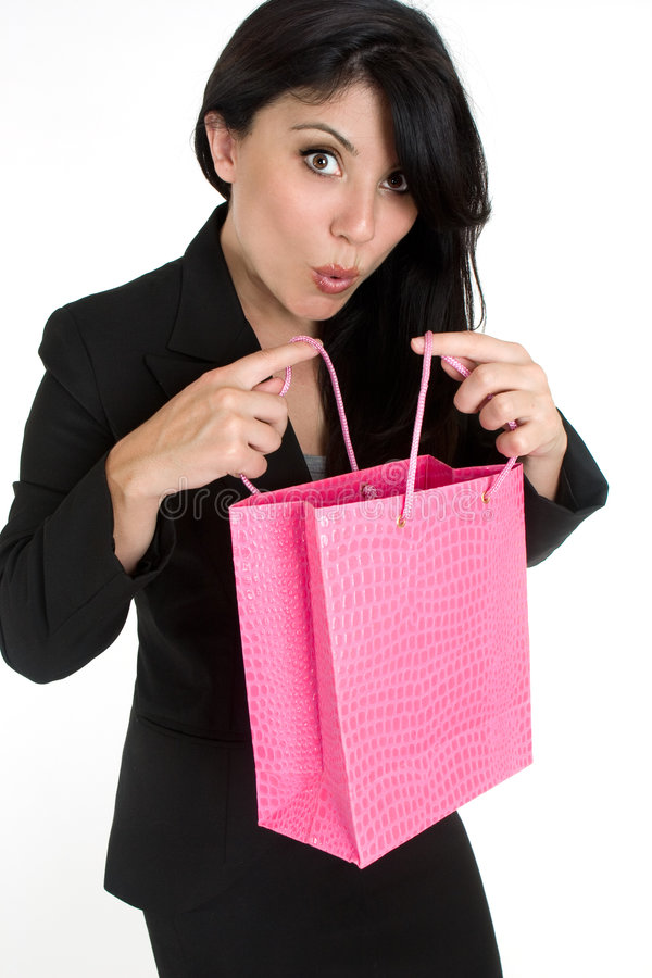 Mujer expresiva con el bolso de compras imagenes de archivo
