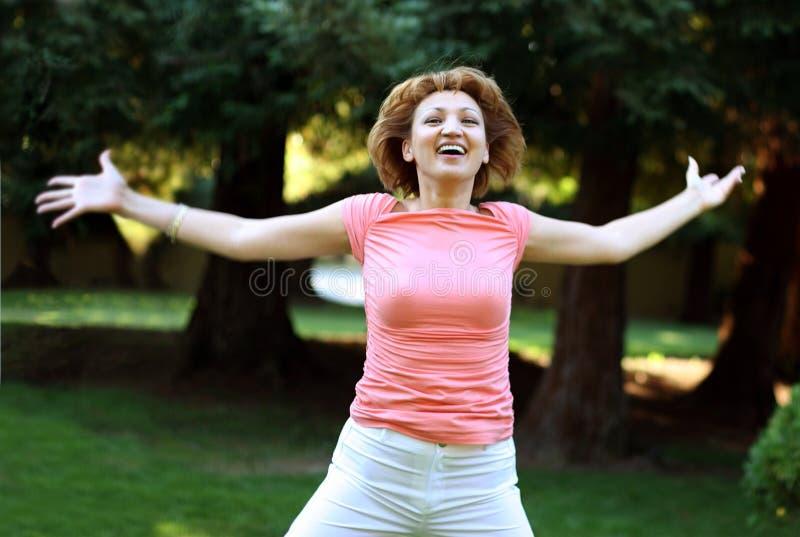 Mujer feliz fotos de archivo