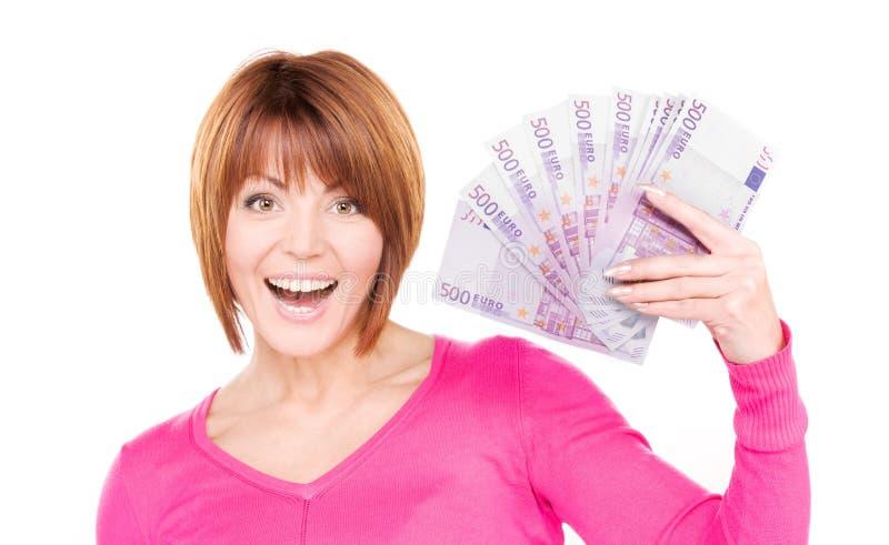 Mujer feliz con el dinero imagenes de archivo