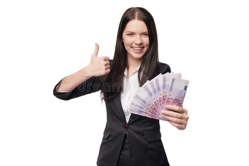 Mujer feliz con el dinero euro a disposición fotos de archivo libres de regalías