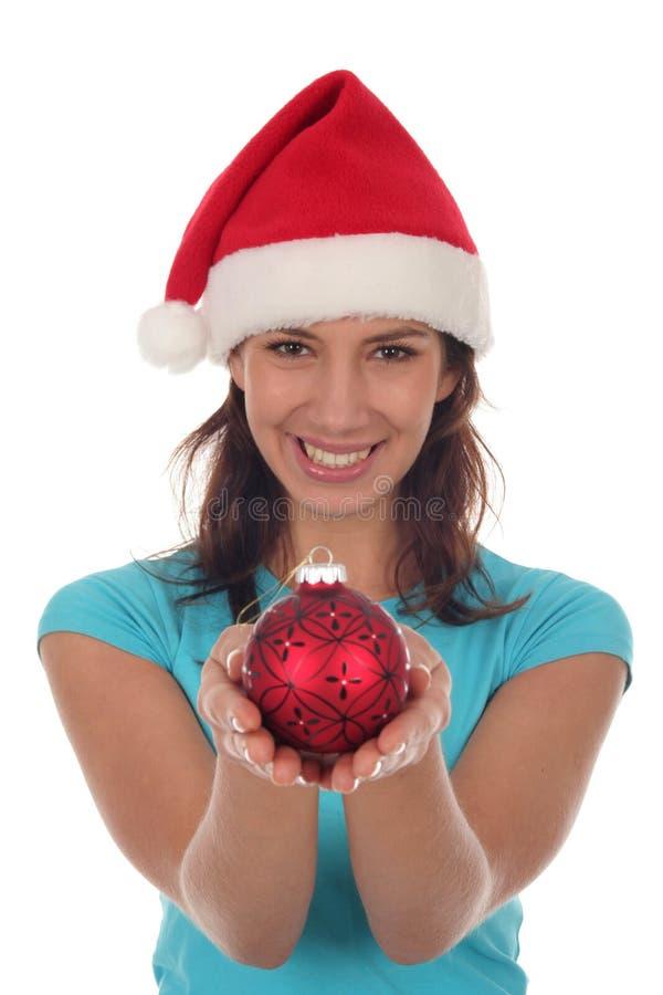 Mujer feliz con el ornamento de la Navidad imágenes de archivo libres de regalías
