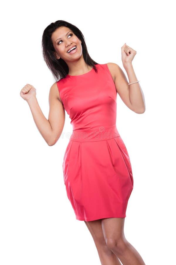 Mujer feliz de la raza mixta que aumenta armas alegría fotografía de archivo libre de regalías