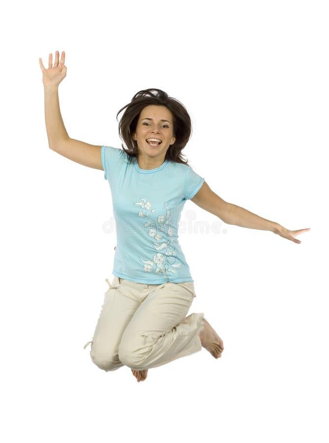 Mujer feliz de salto imagen de archivo