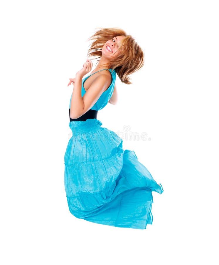 Mujer feliz de salto aislada foto de archivo libre de regalías