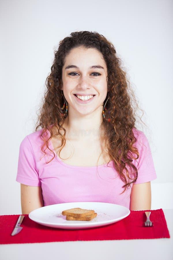 Mujer feliz en su desayuno fotos de archivo libres de regalías
