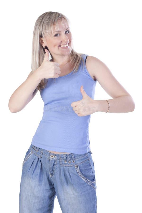 Mujer feliz joven que muestra a mano la muestra aceptable fotografía de archivo