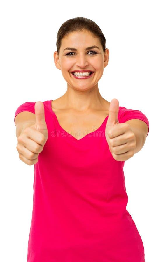 Mujer feliz que gesticula los pulgares para arriba foto de archivo libre de regalías