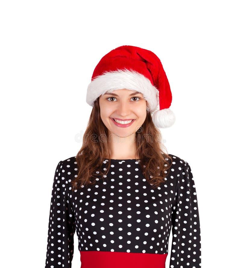Mujer feliz sonriente en alineada muchacha emocional en el sombrero de la Navidad de Papá Noel aislado en el fondo blanco Concept fotos de archivo libres de regalías