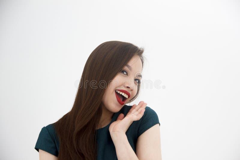 Mujer feliz y del beatifull en el fondo blanco foto de archivo