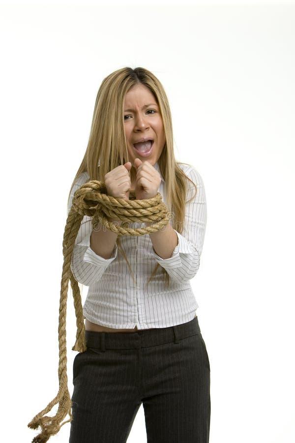 Mujer frustrada con las manos atadas imágenes de archivo libres de regalías