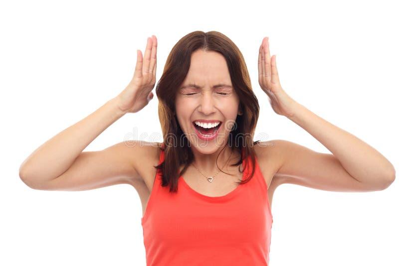 Mujer frustrada que grita fotografía de archivo libre de regalías