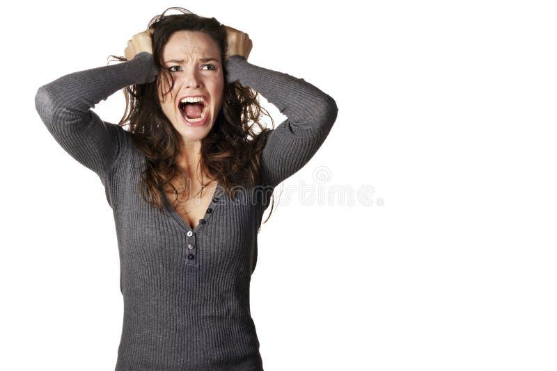 Mujer frustrada y enojada que grita fotos de archivo
