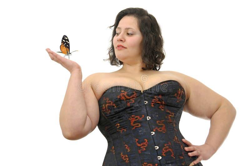 mujer grande con la mariposa fotos de archivo