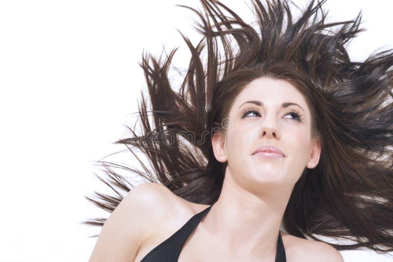 Mujer hermosa con el pelo windblown imágenes de archivo libres de regalías