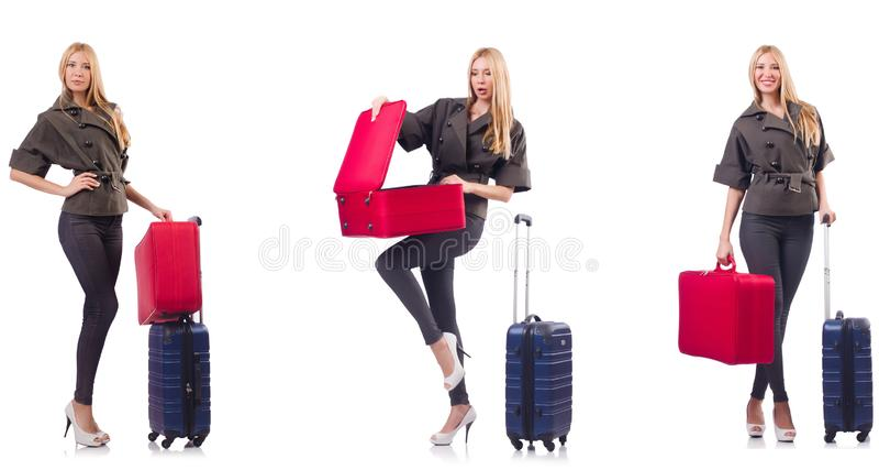 Mujer hermosa con la maleta en concepto de las vacaciones foto de archivo