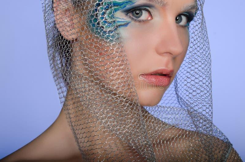 Mujer hermosa con la sirena del arte de la cara fotografía de archivo