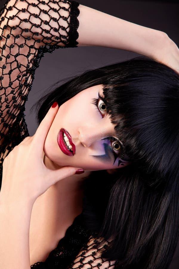 Mujer hermosa con maquillaje de la manera imagen de archivo libre de regalías
