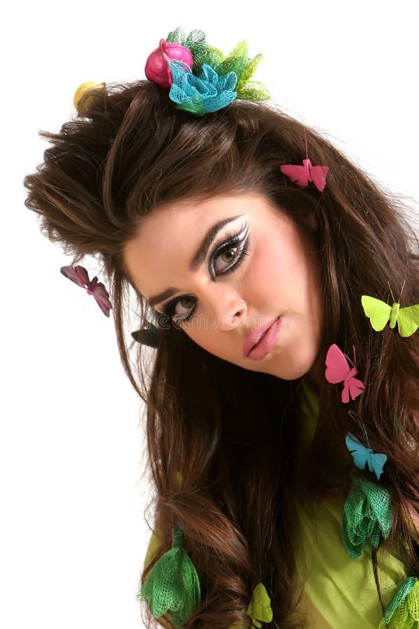 Mujer hermosa con maquillaje y el peinado fotografía de archivo