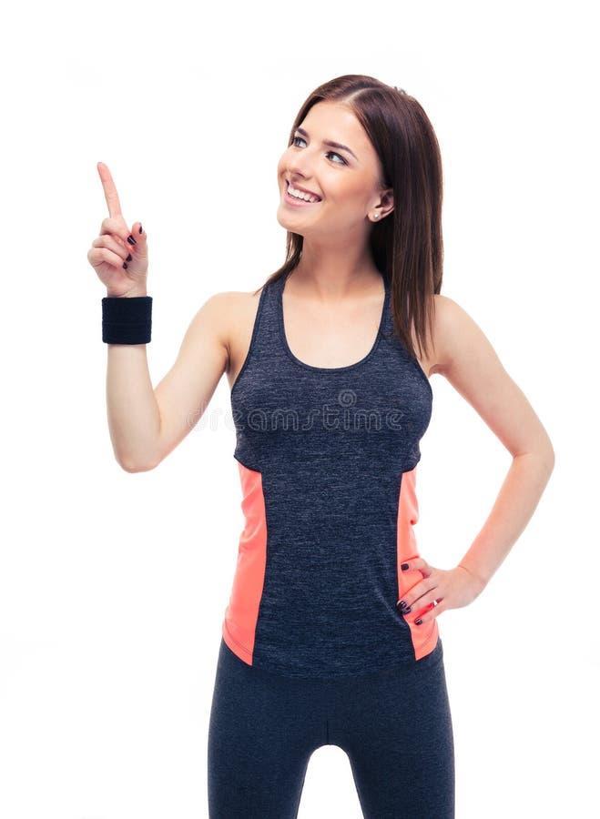Mujer hermosa de la aptitud en ropa de deportes que destaca foto de archivo