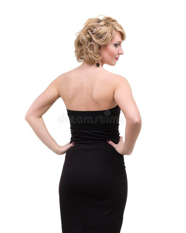 Mujer hermosa en el vestido negro aislado en blanco foto de archivo libre de regalías