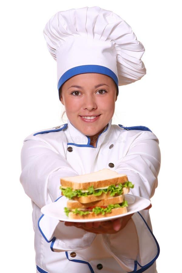 Mujer hermosa en imagen del cocinero fotos de archivo libres de regalías