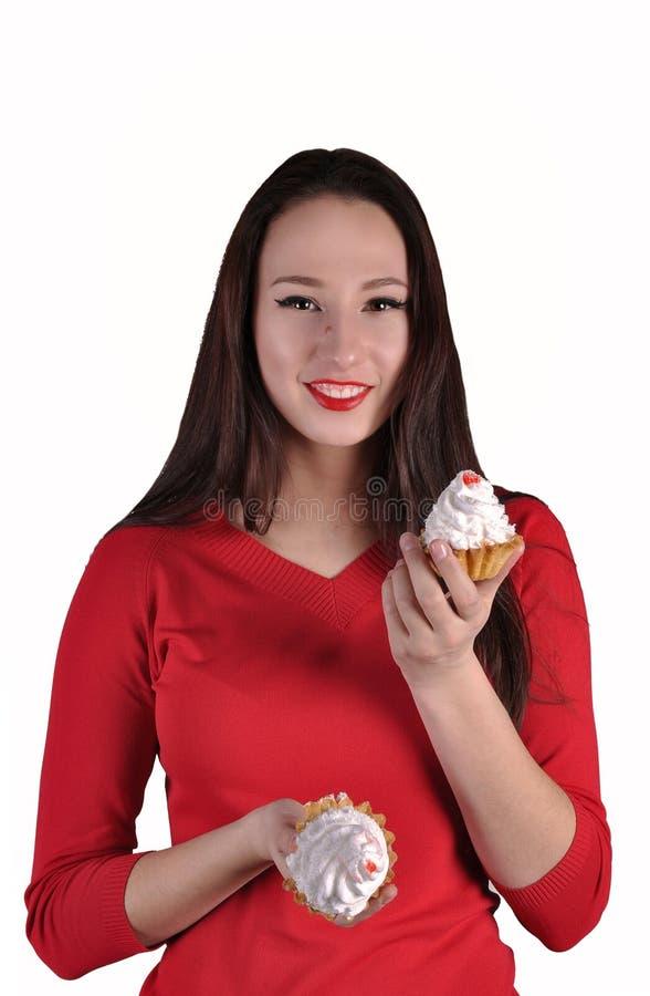 Mujer hermosa feliz con las tortas foto de archivo