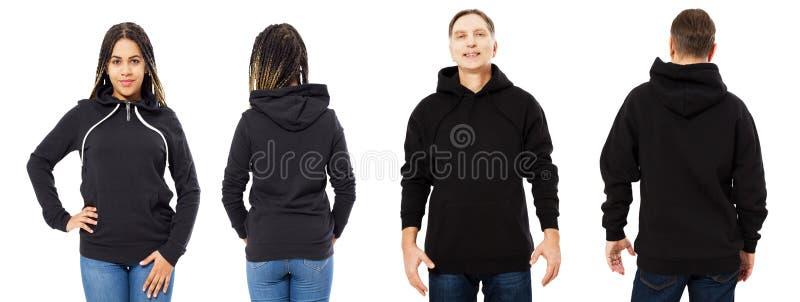 Mujer hermosa negra y hombre de mediana edad en mofa negra de la sudadera con capucha para arriba aislados sobre el fondo blanco imagen de archivo