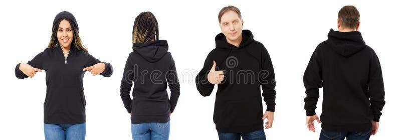 Mujer hermosa negra y hombre de mediana edad en mofa negra de la sudadera con capucha para arriba aislados sobre el fondo blanco imagen de archivo libre de regalías