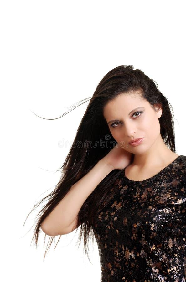 Mujer hispánica joven con soplar del pelo foto de archivo libre de regalías